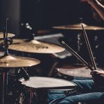 Why Drummers Play Behind Glass – Musical FAQs